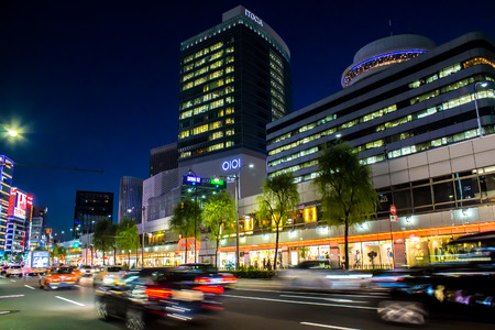 Tokyo: TOKYO, JAPAN - OCTOBER 08, 2015: cars in motion in the evening in the Ginza district in Tokyo, Japan