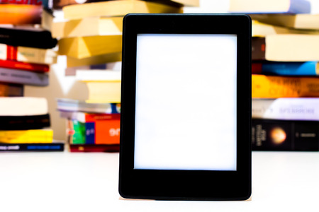 book reader: Electronic book reader on background of books