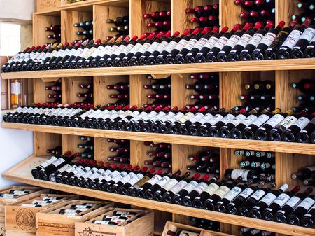 saint emilion: Saint Emilion, FRANCE - APRIL 13, 2015 - wooden racks with red wine bottles in a shop Editorial