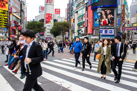 distric: TOKYO, JAPAN - OCTOBER 10, 2015 - Shibuya Crossing, One of the worlds most used pedestrian scrambles, at Hachiko Square in Shibuya special ward.