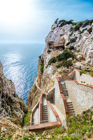 capo: The stairway leading to the Neptunes Grotto, in Capo Caccia cliffs, near Alghero, in Sardinia, Italy Stock Photo