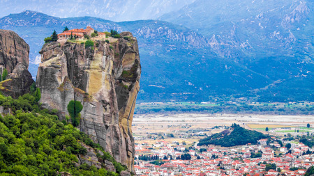 Panoramic view of a monastery in a pinnacle at Meteora, one of the largest and most important complexes of Eastern Orthodox monasteries in Greece Stock Photo