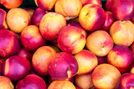 Heap Of fresh ripe Peaches in a box Stock Photo