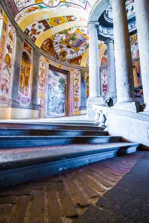 helical: CAPRAROLA, Italy - November 1, 2016 -The SCALA REGIA, the principal staircase of Villa Farnese in Caprarola, Italy; a spiral of steps designed by Vignola and frescoed by Antonio Tempesta