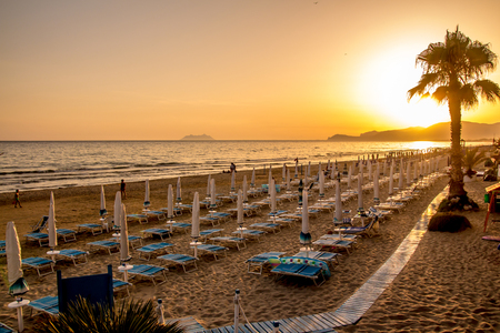 sunset on the beach of Sperlonga, with the Circeo promontory in the background, Italy 写真素材