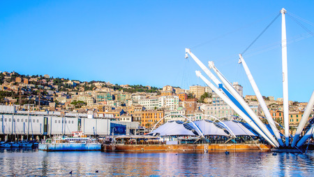 The port of Genoa, with the cityscape in the background, Italy