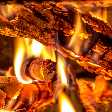 closeup of burning wood in a fireplace Stock Photo