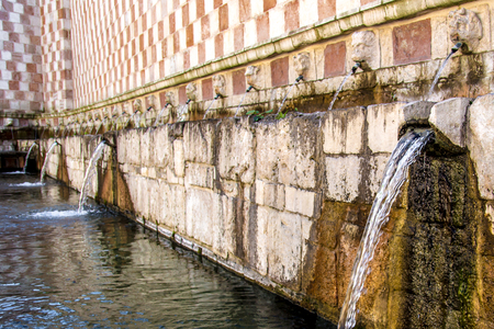99: Fountain of the 99 Spouts (Fontana delle 99 cannelle), Historic fountain with 99 jets distribuited along three walls, L Aquila, Italy