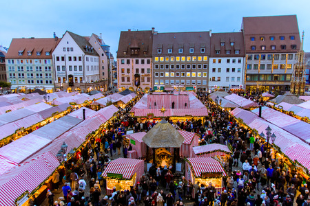 NUREMBERG - GERMANY - DECEMBER 2, 2017: view of the Christkindlesmarkt, at Christmas market in the Hauptmarkt, the central square in Nuremberg old town, Germany.