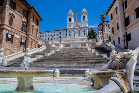 View of the famous Piazza di Spagna in Rome, from the Fountain of the boat, with the Spanish steps and the church of Trinità dei Monti