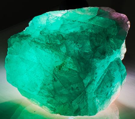 Fluorite mineral stone gem crystal green magenta lit from behind Stock Photo