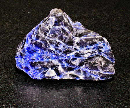 black blue sodalite veined mineral stone black background