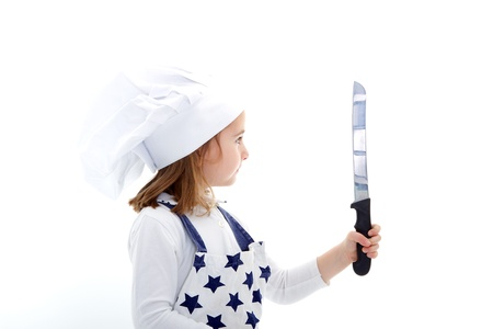child chef cook with kitchen knife in a white background