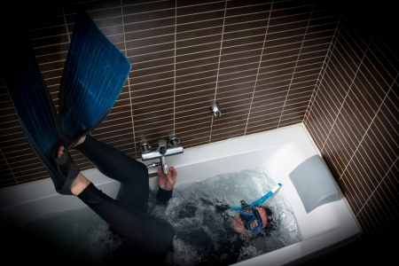 immersion: diver immersion in a bathtub Stock Photo