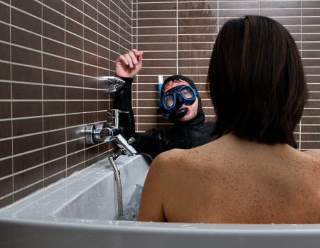 bizarre woman and diver in a bathroom