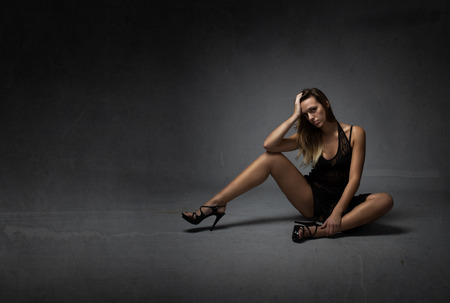 sexy model looking with high heels, dark background Stock Photo