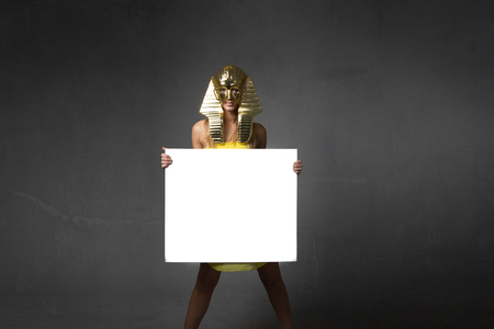 pharaoh woman with white empty board, advertising concept