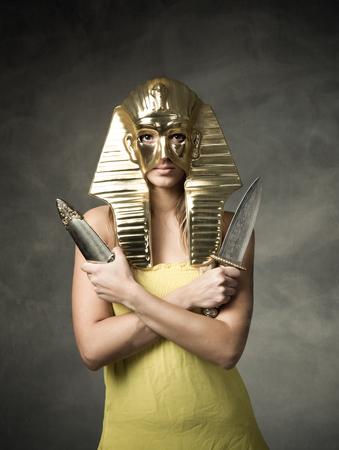 egyptian pharaoh mask, dark and foggy background Stock Photo
