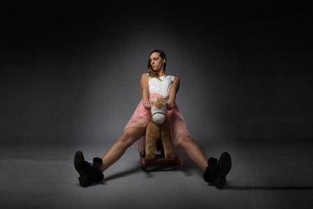 girl riding a rocking horse, open legs Stock Photo