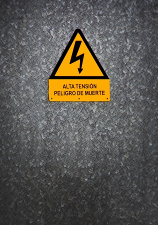 warning sign on gray background in Asturias, Spain photo