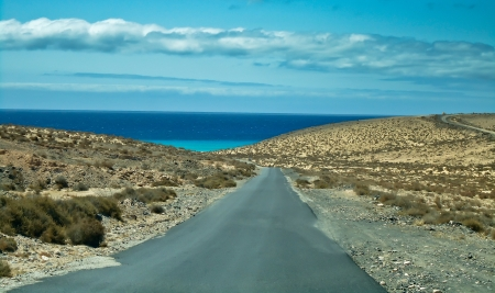 Road in the direction of Sotavento Beach in Fuerteventura, Spain photo