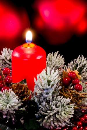 christmas composition with candle and shrubs photo