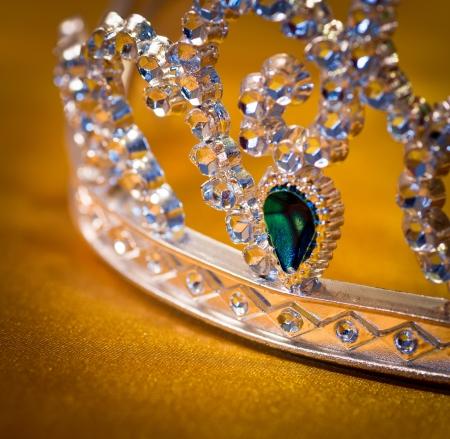 tiara: jeweled crown made of plastic