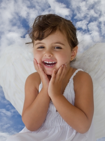 little angel smiling in heaven photo