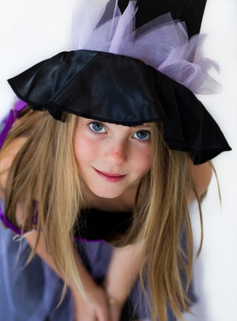 little witch in haloween party photo