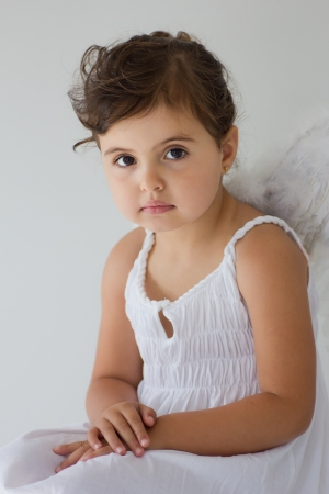 portrait of little girl with angel wings photo