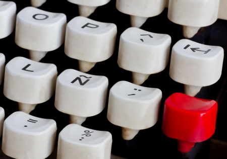 typewriter keyboard with a red key photo