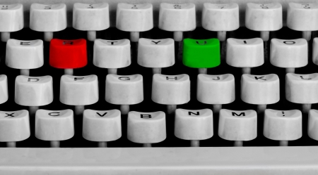 typewriter keyboard with a red and green key photo