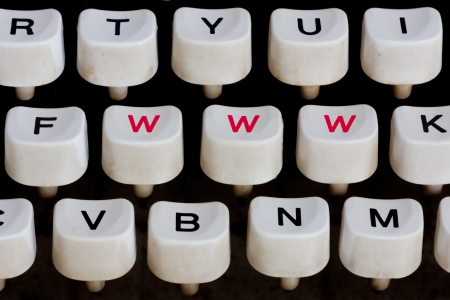 typewriter keyboard with 3 red letters photo