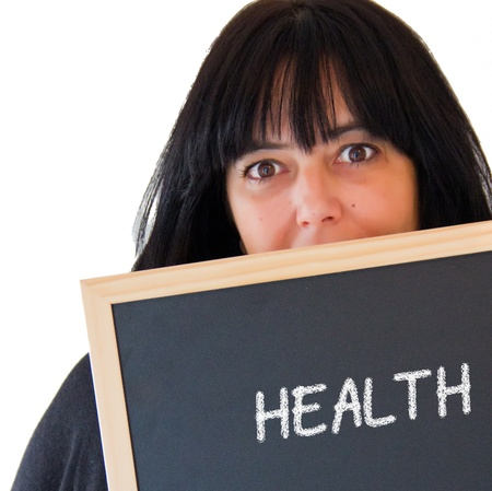 woman with a slate board and health word written Stock Photo - 16934793
