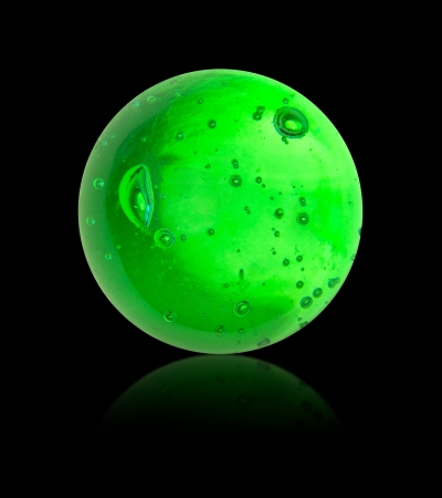 glas: green glas ball with bubbles isolated on black
