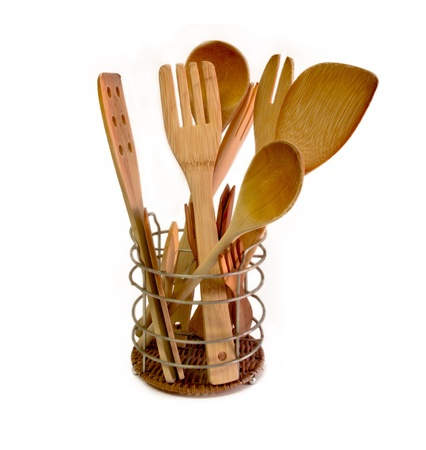 wooden kitchen utensils on white background photo