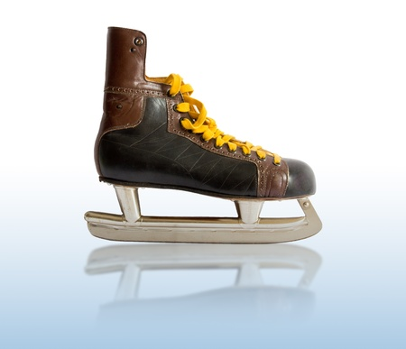 old ice skates with yellow cordage photo