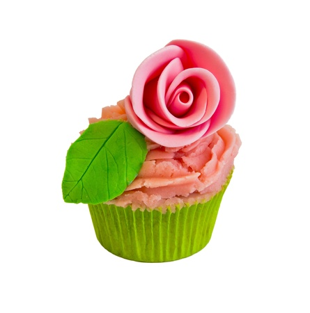 cup cake with rose and leaves isolated on white photo