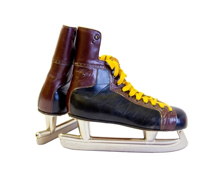 cordage: old ice skates with yellow cordage Stock Photo