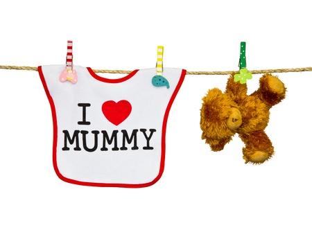 clothesline with a bib and teddy bear photo