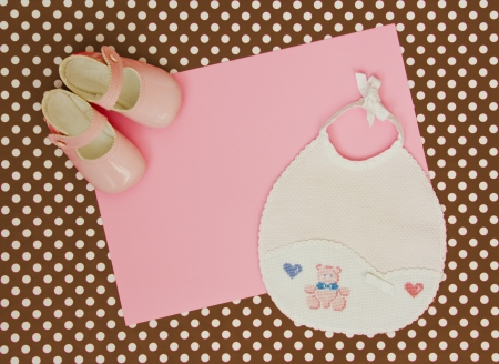 home birth: blank baby shower invite with pink shoes and bib Stock Photo