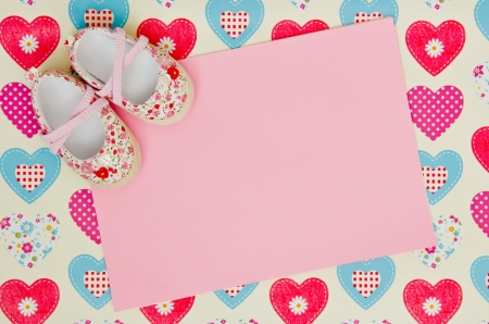 baby girl shower: blank baby shower invite with shoes Stock Photo