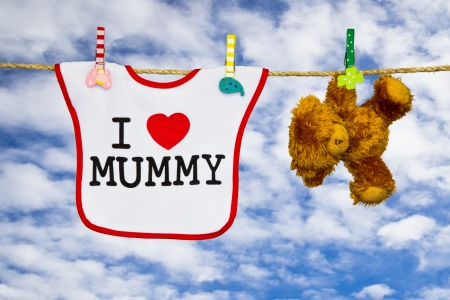 clothesline with a bib and teddy bear photo