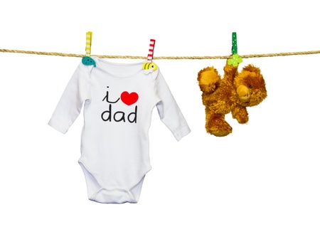 clothesline with a teddy bear and baby clothes Stock Photo - 18340222