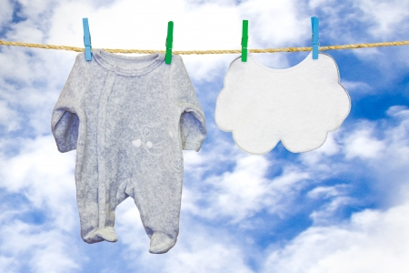 clothesline with a bib and baby clothes Stock Photo - 18340232