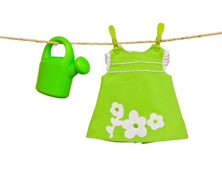 clothesline with baby clothes and sprinkler photo