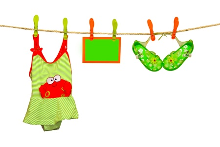 clothesline with swimsuit and flip flops Stock Photo - 18446765