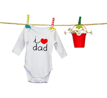 clothesline with a bib and baby clothes Stock Photo - 18446761