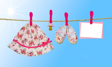 clothesline with shoes, hat and pacifier photo