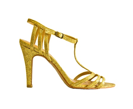 golden heel shoe isolated on white photo